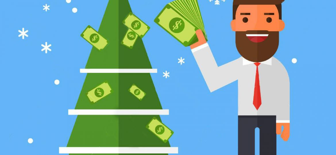 Businessman decorates a Christmas tree with money